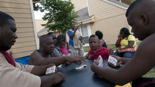 Robert Johnson (far left), Larry Williams (second from left), and DeNarious Scales (far right) play dominoes outside the White Rock Lake Townhomes on Thursday, April 26, 2012, in Dallas, Tx.
