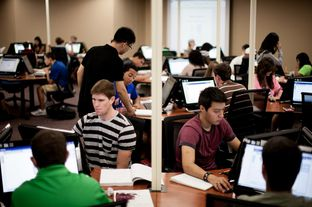 "University of Texas at Arlington students work on college algebra in the university's new ""math emporium"" on Aug. 29, 2012."