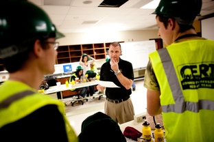 Denton ISD Advanced Technology Complex disaster response teacher, Jeff Arrington, works hands on with his students during a class project.