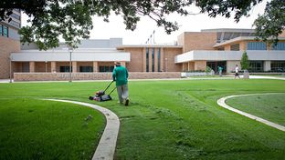 Landscaping workers are among the Texas A&M University employees who will have to join an outside company, because A&M is outsourcing its support services.