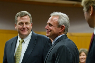 Michael Morton stands in a Williamson County courtroom with his attorneys after murder charges against him were officially dropped.