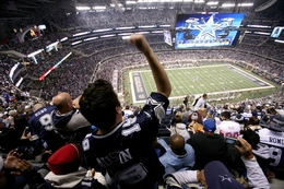 Mexican Dallas Cowboys fan Gustavo Lara Jr. of Monterrey, Mexico cheers at Cowboys Stadium while on a tour bus package from Monterrey, Mexico to see the Cowboys play the New York Giants in Arlington, Texas on Sunday, December 11, 2011.