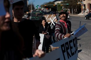 Miguel Rodriguez and other activists march down an Austin, Texas street in support of the jailed political activists who were detained during the inauguration of Peña Nieto on Dec. 1, 2012 in Mexico. The march began at the Mexican Consulate and ended at the State Capitol in Austin, Texas.