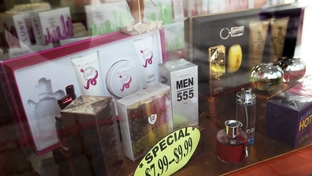 Perfume displayed in the window of one of Mr. Datta's stores in downtown Laredo, Saturday, November 5, 2011.
