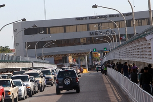 A bridge to Mexico that is near the busy downtown Laredo shopping area is shown on Nov. 5, 2011.