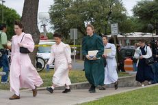 FLDS members arriving at the Tom Green County Courthouse in San Angelo, Texas for the first day of court hearings on the custody of the hundreds of children taken by the state of Texas from the compound on April 17, 2008.