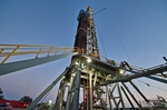 An oil & gas drilling rig is drilling a well for Pioneer Natural Resources in the Eagle Ford Shale formation near Yorktown.