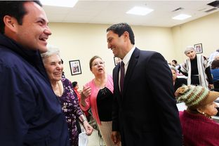 State Representative Trey Martinez-Fischer, right, and District 7 Councilman Justin Rodriguez, left, greet Rodriguez's grandmother, Inez Randon Ramirez, and her friend, Mary Barker as they get out the message to vote at the Alicia Trevino Lopez Senior Center in San Antonio, Friday, October 26, 2012.