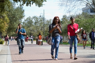 Texas Southern University students Chassity Piece (center) and Briana Falls (right) walk to class, Feb. 22nd, 2012.