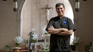 Co-director of the Metropolitan Organization Kevin Collins standing in Immaculate Conception Church where he serves as a priest.