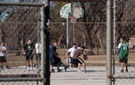 Men play basketball at Lake Cliff Park in Oak Cliff, a south Dallas neighborhood.