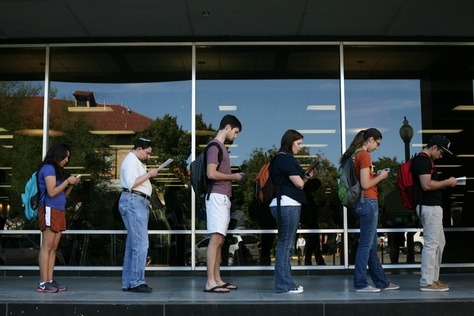 Voters wait in line to cast their ballots at the Flawn Academic Center on the University of Texas at Austin campus on Tuesday, Nov. 6, 2012 in Austin, Texas.