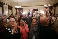 Democratic supporters at the Driskill Hotel in Austin erupt in celebration as CNN projects President Obama's re-election victory on Nov. 6, 2012.