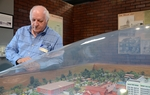 Jim Willett, director of the Texas Prison Museum and former warden of the Walls Unit, looks at a scale model reproduction of the unit where he oversaw 89 executions.