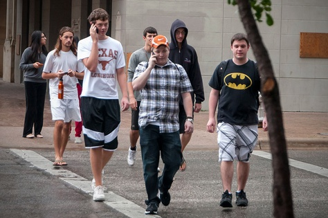 Evacuated UT students wandered into downtown Austin while they waited for news about the bomb threat on campus. (September 14, 2012)
