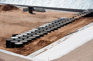 Modular Concrete Canisters (MCC) containing nuclear waste at bottom of storage pit near Andrews, Tex.