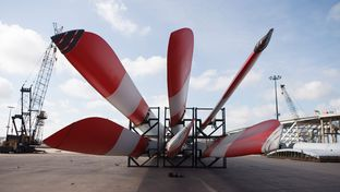 Stacks of huge blades, destined to go to wind farms in the United States, arrive at the Port of Houston docks on Sept. 6, 2012.