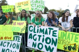 College students protest on the green at Dartmouth prior to the Republican Debate on October 11, 2011 in Hanover, NH