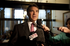 Gov. Rick Perry speaks to the press after leaving a school finance meeting between leaders in the House and Senate May 27, 2011.