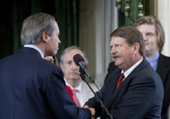 Lt. Gov. David Dewhurst, shakes hands with Sen. Mike Jackson R-District 11, after being sworn in as Senate President Pro Tempore on May 30th, 2011