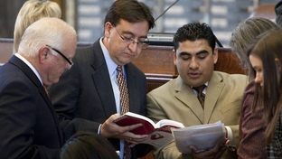 Rep. Peter Gallego D-Alpine reviews the Texas House Practice book with Rep. Armando Walle D-Houston while discussing HB 14 regarding Voter ID on March 23rd, 2011
