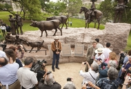Tejano monument artist Armando Hinojosa in front of the sculpture after its unveiling ceremony on the grounds of the Texas Capitol on March 29, 2012.