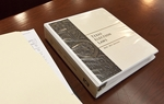 Copy of Texas Election Law binder on desk before election contest hearing for House District 48