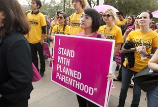 Planned Parenthood supporters rally at the Capitol on Tuesday morning.