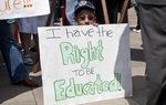 Young boy protests school budget cuts during the Texas American Federation of Teachers rally at the Capitol. March 14th, 2011.