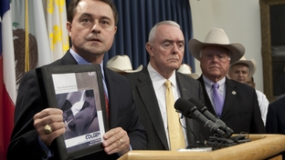 Texas Department of Agriculture Commissioner Todd Staples, holds up copy of recently released independent copy of Texas border security during press conference at Texas Capitol on September 26th, 2011