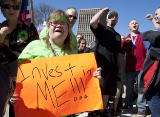People with disabilities rally at Texas Capitol opposing budget cuts to home and community-based services. March 1st, 2011