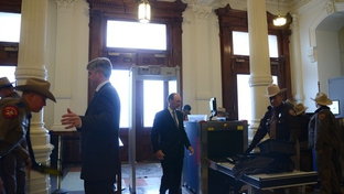 Capitol visitors pass through metal detectors.