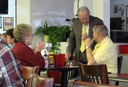 Rep. Delwin Jones (standing) talks to voters in a Lubbock diner.