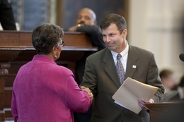 State Rep. David Simpson (r), R-Longview, shakes hands with 'puppy mill' bill sponsor State Rep. Senfronia Thompson (l), D-Houston, after debate on April 26, 2011.