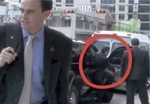 Screengrab of Perry's staffer heading to block a KBH videographer from the sidewalk.