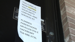 Sign on door of Mission clinic informs patients to go elsewhere.