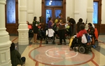 A dozen protestors from disability rights group ADAPT gathered at Gov. Rick Perry's office this afternoon to block the entrances. Organizers say they wont leave until Perry pledges to oppose cuts to community services.
