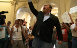 "Infowars radio host Alex Jones protests in the halls of the Texas Capitol on Monday after legislators pass altered version of the TSA ""anti-groping"" bill."