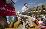 At the Iowa State Fair in Des Moines, Gov. Rick Perry, knee high in haystacks, challenged President Obama on job creation.