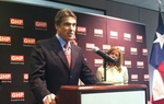 Gov. Rick Perry said Wednesday he isn't worried that a failure to increase the nation's debt ceiling would trigger an economic catastrophe. He also says that it should be up to the states to decide whether abortion is illegal — or legal.