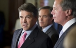 Gov. Rick Perry, House Speaker Joe Straus and Lt. Gov. David Dewhurst on Tuesday touted the accomplishments of the regular session: cutting the state budget without raising taxes or tapping the Rainy Day Fund.