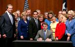 Gov. Rick Perry signed House Bill 2 — the omnibus abortion legislation — into law Thursday morning.