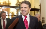 Gov. Rick Perry responds to questions about embattled media baron Rupert Murdoch's contributions to the Republican Governors Association.