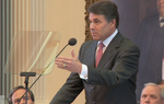 "Gov. Rick Perry told lawmakers Tuesday he is against tapping the state's $9.4 billion Rainy Day Fund to close the budget shortfall: ""That approach would not only postpone tough, necessary decisions."""