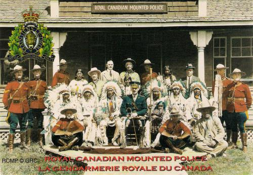 RCMP officers pose with Aboriginal People during the Calgary Stampede in 1924