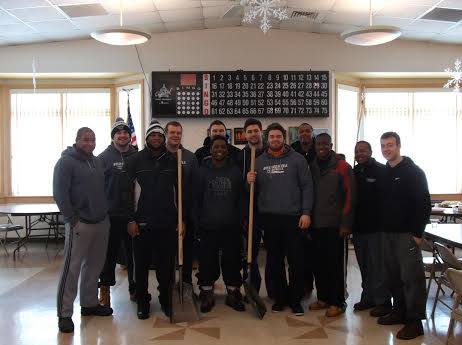 Football Team helping Brockton residents shovel out