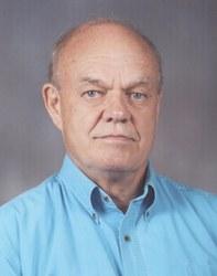 Raymond E._Suzor, Jr.