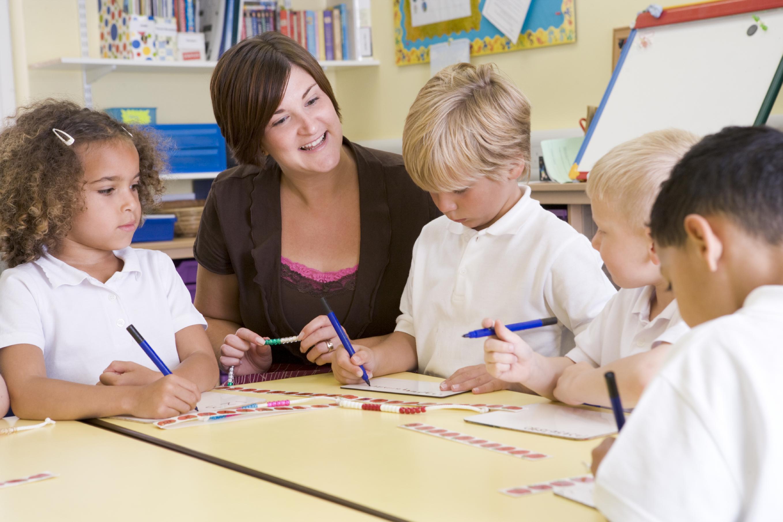 Schoolchildren and their teacher in a primary class