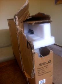 Kogan TV delivered damaged carton box