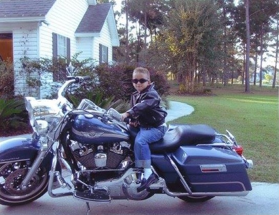 kid in leather on motorcycle